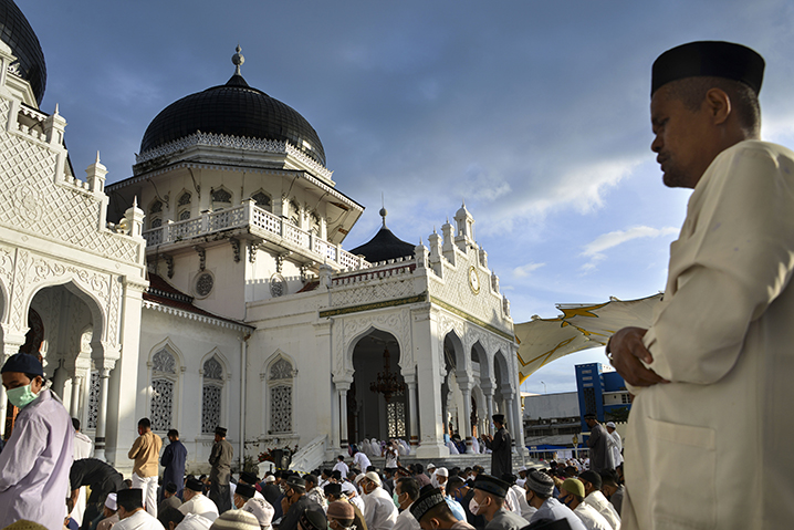 Indonesians attend an Eid al-Fitr prayer at Baiturrahman grand mosque in Banda Aceh